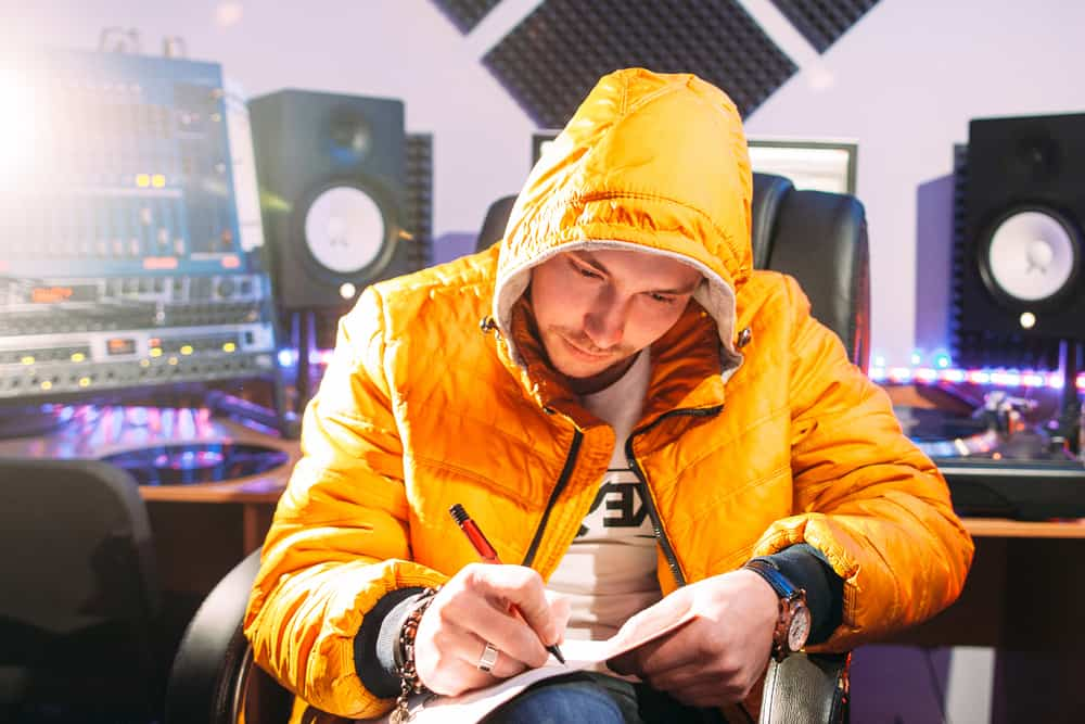 DJ writes new lyrics in recording studio